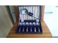 Vintage boxed set of six dessert spoons and serving spoon. Sheffield stainless steel chrome plate.
