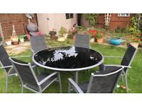 Large glass garden table with 6 chairs and table cover