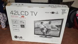 LG 42-inch Widescreen Full HD 1080p LCD TV + Premier LCD Glass TV Stand