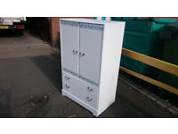White flower patterned tallboy with double drawer (delivery available)