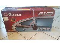 Razor E100 silver electric scooter, still in box! duplicate gift, retails for £150