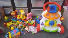 Bundle of baby toys including walker
