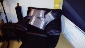 Black leather armchair £200..00