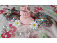 Set of 3 hand-knitted booties. Newborn