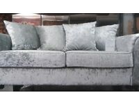 3 sitter and 2 sitter sofas for sale. The sofas are brand and its in velvet silver colour. on sale .