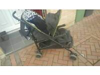 Double tandem pushchair / stroller