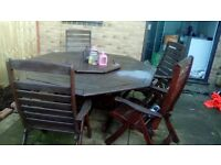 Wooden very heavy garden table with six heavy wooden chairs