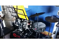 8 Piece Drum Kit + stool, spare and double foot pedal, ear protection and extras.