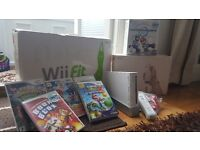 NINTENDO WII PLUS FIT BOARD PLUS GAMES!