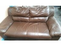 Brown 2 seater leather sofa in good condition!