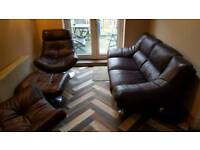 Two seater leather sofa and swivel chairs