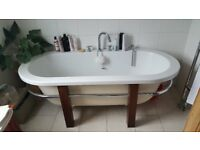 Free standing bath on hard wood frame