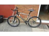 Men's 21 speed Saracens Rufftrax mountain bike.