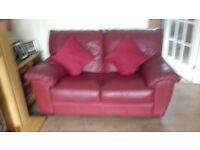 Burgundy sofa and chair