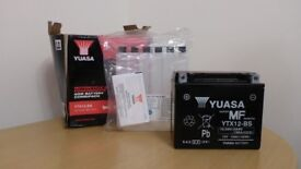 Yuasa YTX12-BS motorcycle battery, including the filling kit, new part