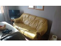 Lovely yellow leather sofa with lovely wooden base