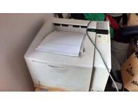 Hewlett Packard Laserjet 5N laser printer - old, big, dependable.