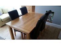 Solid Oak Table and 4 Matching High Back Chairs in very good condition.