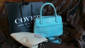 Gorgeous designer handbag by Coccinelle. Stunning aqua blue croc effect leather. Summer Must have!!