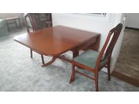 Parker-Knoll dining table and 6 chairs