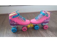 Good condition size 2 girls roller boots