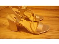 Gold high heels size 8 brand new