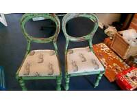 2 pineapple print wooden chairs