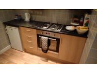 Kitchen units with cooker hob and extractor