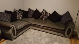 Black and grey left hand corner sofa and poufee