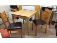 Table light oak colour and 2 chairs, seat dark brown