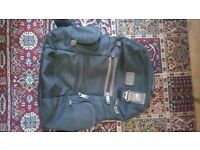 Tumi backpack no longer needed. Great condition. Lots of pockets and laptop storage area.