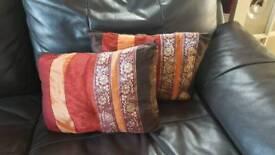 2 red/gold/orange/brown cushions