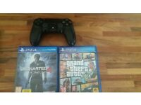 black ps4 controller and 2 games