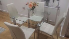 4 Good Quality Next co uk white dining chairs, fax leather and chrome legs