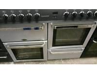 Black and silver 8 burner dual fuel range cooker.