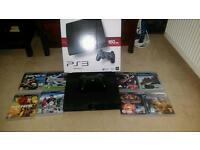 PS3 Slim with 8 games.