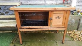 3ft easipet guinea pig/rabbit hutch.hardly used. Chewing to inside wood.Slide tray for easy cleaning