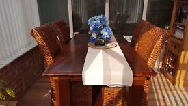 Extending dining table & 4 wicker chairs