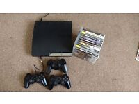 PS3 Slim. 3 controllers + games.