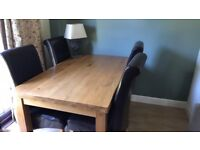 Solid oak dinning room table and four real leather/ oak dark brown chairs!