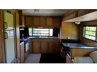 Large 4 berth American pop-out side caravan, in great condition