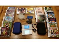 Nintendo DS Lite (white) with bundle of 17 games, 2 cases and storage boxes