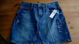 Two jean skirts kids, ladies new with tags. Christmas present?