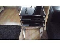 Clear glass shelving chrome frame. Black glass nest of tables chrome frame