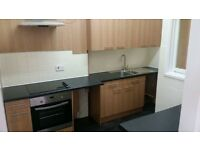 2 bedroom second floor flat. double glazing central heating. new kitchen and carpets in stoke.