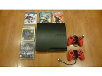 PlayStation 3 Slim 160GB (incl. 2 controllers & 5 games)