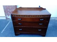 A beautiful set of old vintage British made draws in beautiful dark wood