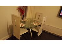Glass dining table with leather chairs for quick sale