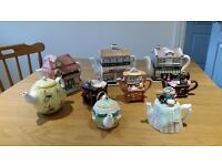 Collection of decorative teapots by Whittard and Village