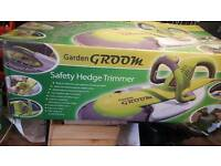 Safety hedge trimmer